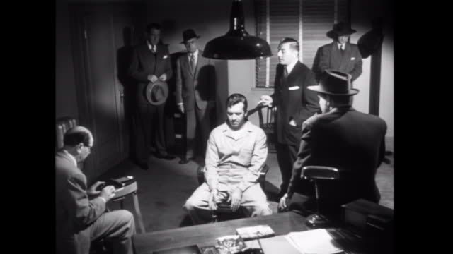 1952 police interrogate an innocent deliveryman in an attempt to prove his guilt - interrogation stock videos and b-roll footage