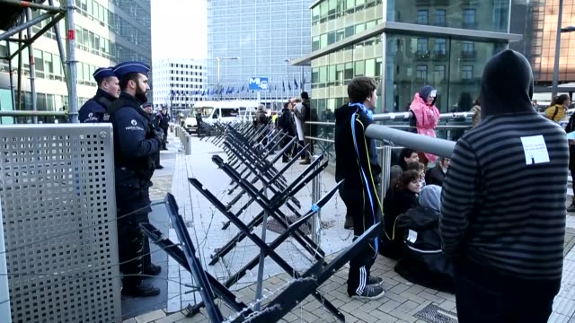 Police intervene when activists block the entrance of the European Commission while they protest in front of the building of the European Commission...