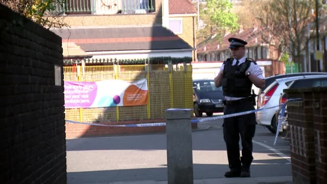 police investigate fatal shooting of teenage boy in north woolwich england london newham north woolwich ext police car and police tape cordon police... - itv london tonight weekend stock videos & royalty-free footage