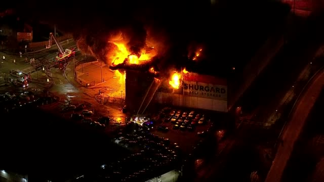 police investigate whether selfstorage warehouse fire investigated as arson england london croydon firefighters tackling huge blaze that destroyed... - self storage stock videos and b-roll footage