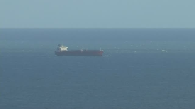 police investigating incident on board oil tanker off the isle of wight; england: isle of wight: ext various shots of oil tanker at sea off coast of... - oil stock videos & royalty-free footage