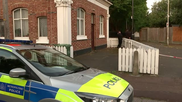 Police investigating Newham murder arrest three people ENGLAND London Newham EXT Police car parked with officers outside house View of forensic tent...