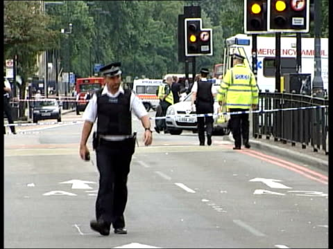 jean charles de menezes shooting key questions file / tx london stockwell station police about outside stockwell station police putting cordon tape... - soft focus stock videos & royalty-free footage