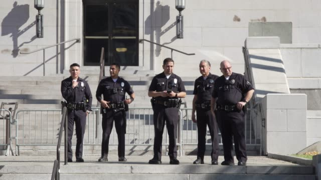 police lapd at jane fonda's fire drill friday at los angeles city hall on february 07 2020 in los angeles california - ロサンゼルス市警察点の映像素材/bロール