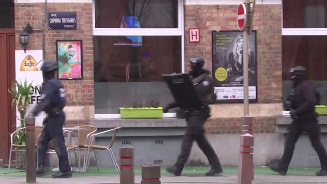 police launch counterterrorism operation linked to the paris attacks armed police officers walk along road - counter terrorism stock videos & royalty-free footage