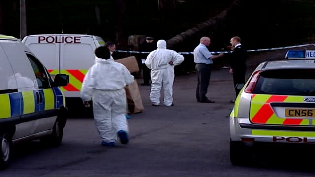 police launch murder investigation after vicar found dead in south wales; wales: trecynon: ext / night kevin edwards interview sot day forensics... - investigatore video stock e b–roll
