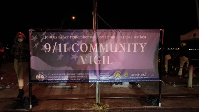 police lights flash against a sign for the 9/11 community vigil at the american veterans memorial pier on september 11, 2020 in bay ridge, brooklyn,... - memorial stock videos & royalty-free footage