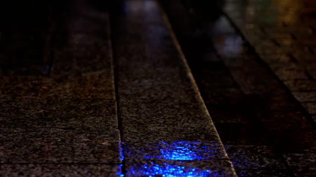 police lights reflected in wet sidewalk - air raid siren stock videos & royalty-free footage