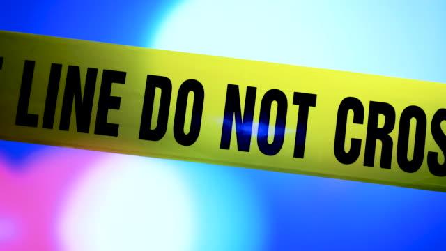vídeos y material grabado en eventos de stock de línea de policía no cinta adhesiva cruzada - investigación criminal