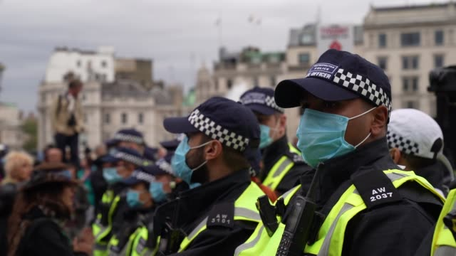 police line up wearing face masks as protesters clash with police officers during a we do not consent antilockdown rally at trafalgar square on... - human head stock videos & royalty-free footage