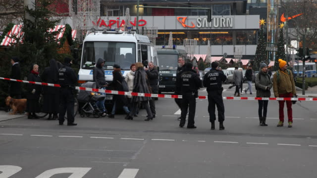 police locks the street to prevent access to the breitscheidplatz where the assassination took place in berlin on the left side you can see the... - assassination stock videos and b-roll footage