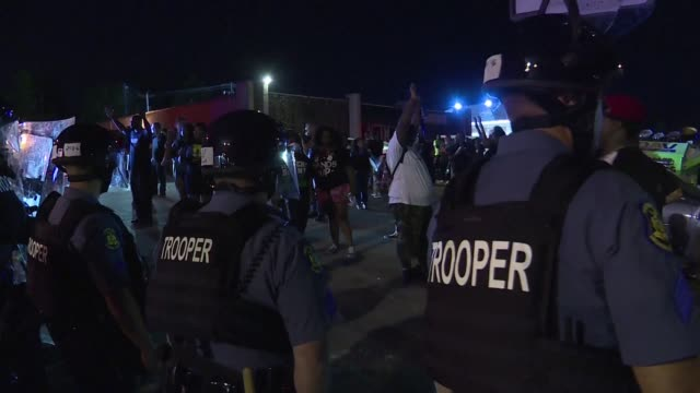 police made numerous arrests during a tense night-time standoff in ferguson, after st. louis county declared a state of emergency and a teenager was... - confrontation stock videos & royalty-free footage