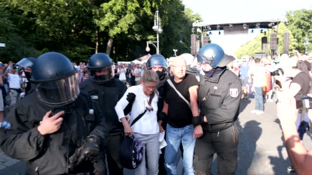 police make an arrest during a protest against lockdown measures and other government policies relating to the novel coronavirus crisis on august 01,... - other stock videos & royalty-free footage