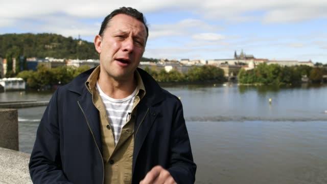 Police make several arrests over murder of anticorruption journalist Czech Republic Prague Pavla Holcova interview Prague EXT Reporter to camera INT...