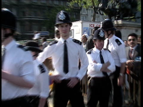 05 police making arrests police standing across road police under attack missiles thrown at police by demonstrators police retreating demonstrators... - arrest stock videos & royalty-free footage