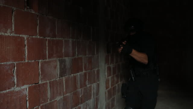 police man with a handgun - firing squad stock videos and b-roll footage