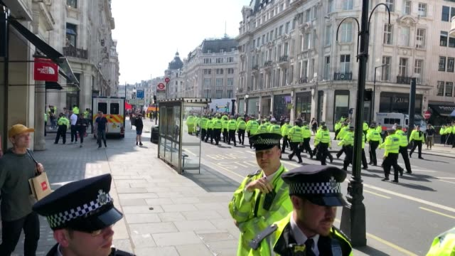 Police march onto Oxford Street to stop the Extinction Rebellion climate change protest London