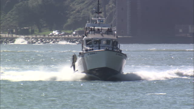 ms, police motor boat approaching to camera, san francisco bay, california, usa - police boat stock videos and b-roll footage