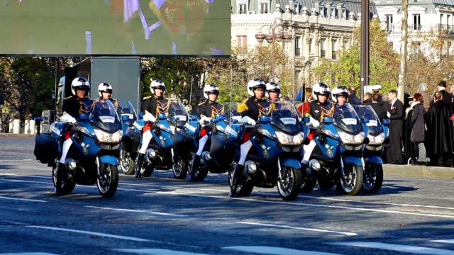 police motor officers waiting at place de l'etoile during remembrance wwi day in paris france - armistice stock videos and b-roll footage