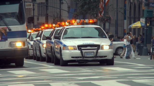 ws police motorcade leaving light at 42nd and 6th avenue / new york city, usa - motorcade stock videos & royalty-free footage