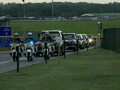 police motorcycle escort lead the hearse containing the body of princess diana and official cars away from raf northolt. 31 august 1997. - dice stock videos & royalty-free footage