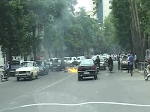 police motorcycle in tehran set alight following results of presidential elections 14 june 2009 - 2009 stock videos & royalty-free footage