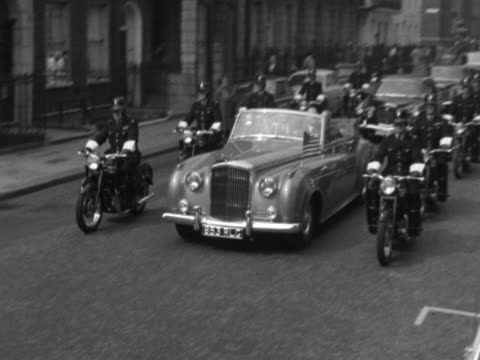 police motorcycles escort president kennedy as his motorcade drives along a london street - motorcade stock videos & royalty-free footage