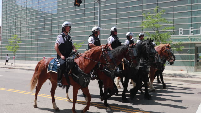 police move in formation on horses as the kkk holds a nearby rally and are met by protesters hundreds of counter protesters including the nation of... - ku klux klan stock videos and b-roll footage