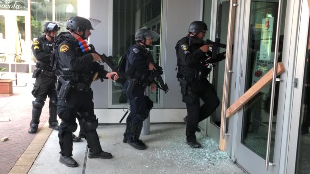 police move in on a store where broken glass remains from being broken into from looters on may 31, 2020 in walnut creek, california. one woman was... - looting stock videos & royalty-free footage