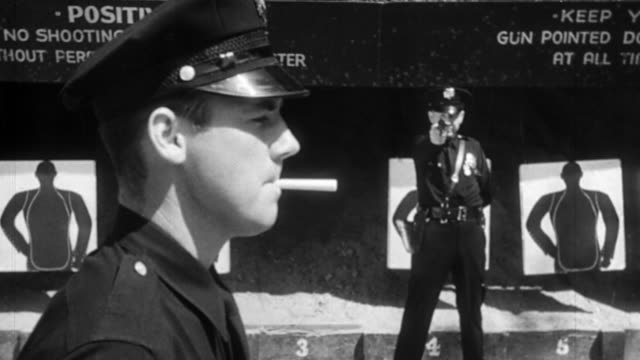 vídeos y material grabado en eventos de stock de b/w 1950 ms police officer aiming + shooting cigarette from mouth of police officer in foreground - apuntar