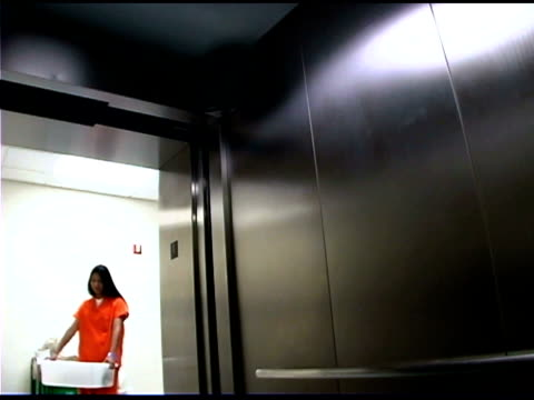 police officer and prisoner on elevator - women prison stock videos & royalty-free footage