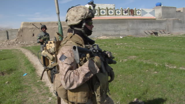 vidéos et rushes de police officer and soldier standing and looking around field / musa qala, helmand province, afghanistan. - opération enduring freedom