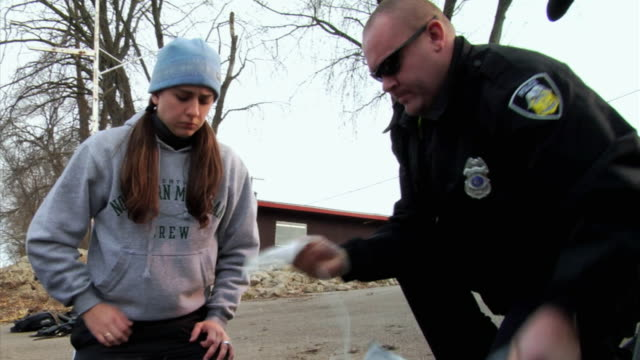 CU MS ZI ZO Police officer applying AED pads to unconscious man, New London, Wisconsin, USA