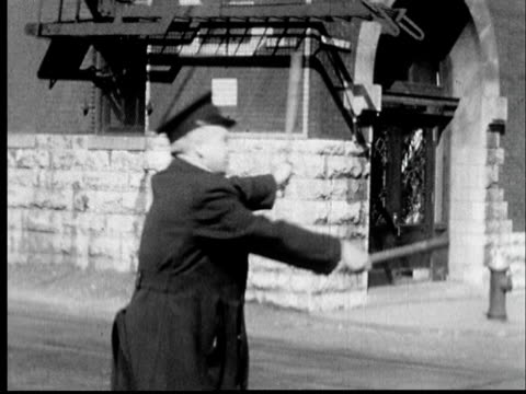 1935 ms police officer comically directing traffic with stop sign and baton/ st. louis, missouri - stop sign stock videos & royalty-free footage
