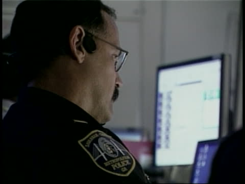 police officer concentrates on a computer screen at a control center for the 2004 g-8 summit. - 2004 stock videos & royalty-free footage
