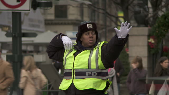 A police officer directs traffic in New York City
