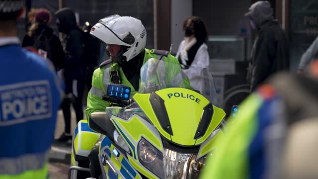 police officer gets on their motorbike as protesters demonstrate during a kill the bill protest on may 1, 2021 in london, united kingdom. this is the... - land vehicle stock videos & royalty-free footage