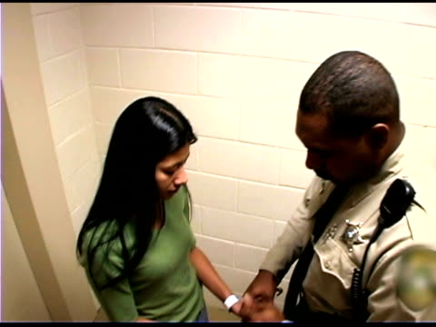 police officer handcuffing criminal - festnahme stock-videos und b-roll-filmmaterial
