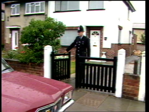 Police officer impersonates Pope John Paul II ENGLAND Merseyside Bootle EXT Billy Bird leaving house wearing police uniform Bird putting on papal...