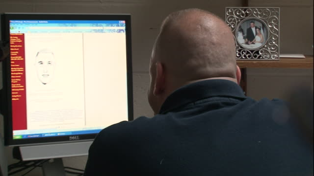 a police officer looks at a suspect's sketch on a computer screen. - suspicion stock videos & royalty-free footage