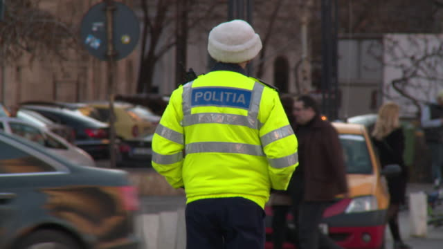 A police officer patrols traffic in Bucharest, Romania.