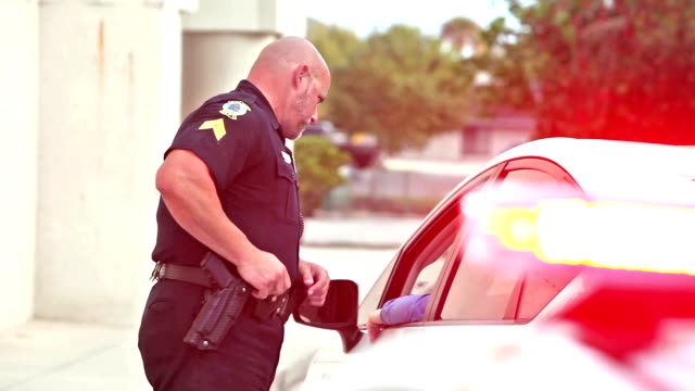 police officer pulling over a driver - police force stock videos & royalty-free footage