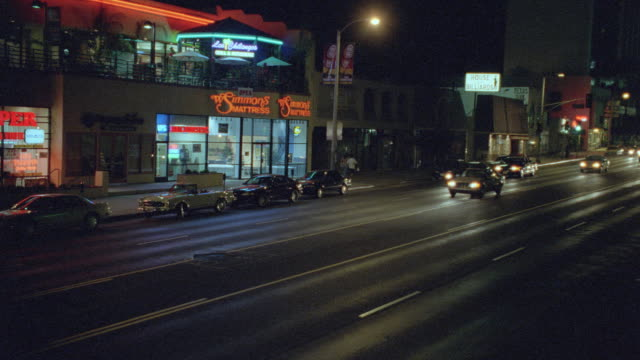 a police officer pulls over a motorist on ventura boulevard in los angeles. - boulevard video stock e b–roll