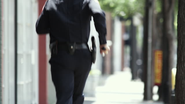 ws police officer running down sidewalk / dallas, texas, usa - see other clips from this shoot 1606 stock videos & royalty-free footage