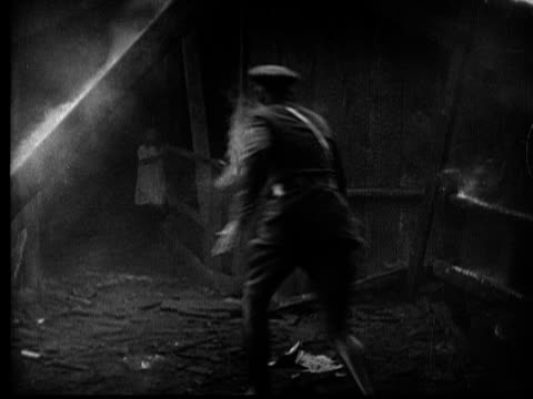 MS, B&W, Police officer running toward girl (8-9) in burning building, 1920's