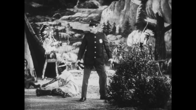 1933 police officer searches for hiding man (harry langdon) in wax museum prairie display - auf den zehenspitzen stock-videos und b-roll-filmmaterial
