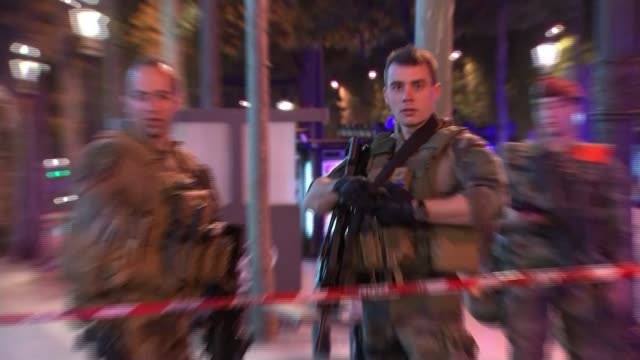 Police officer shot dead in attack on ChampsElysees Police officer shot dead in attack on ChampsElysees ChampsElysees Reporter to camera Firefighters...