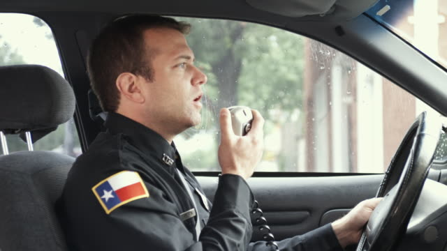 ms zo police officer sitting in police car talking on cb radio and using computer / dallas, texas, usa - see other clips from this shoot 1606 stock videos & royalty-free footage