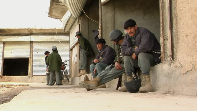 ms police officer sitting outdoors / musa qala helmand province afghanistan - legs crossed at ankle stock videos and b-roll footage
