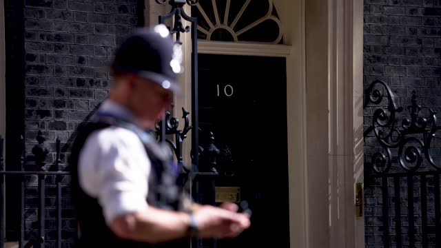 police officer stands guard at downing street ahead of the state opening of parliament at downing street on may 11, 2021 in london, england. - politics and government stock videos & royalty-free footage